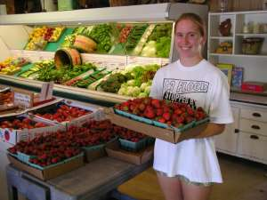 Jessica Putting More Strawberries out to Sell